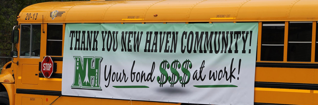 Photo of a bus with a sign thanking for the bond money