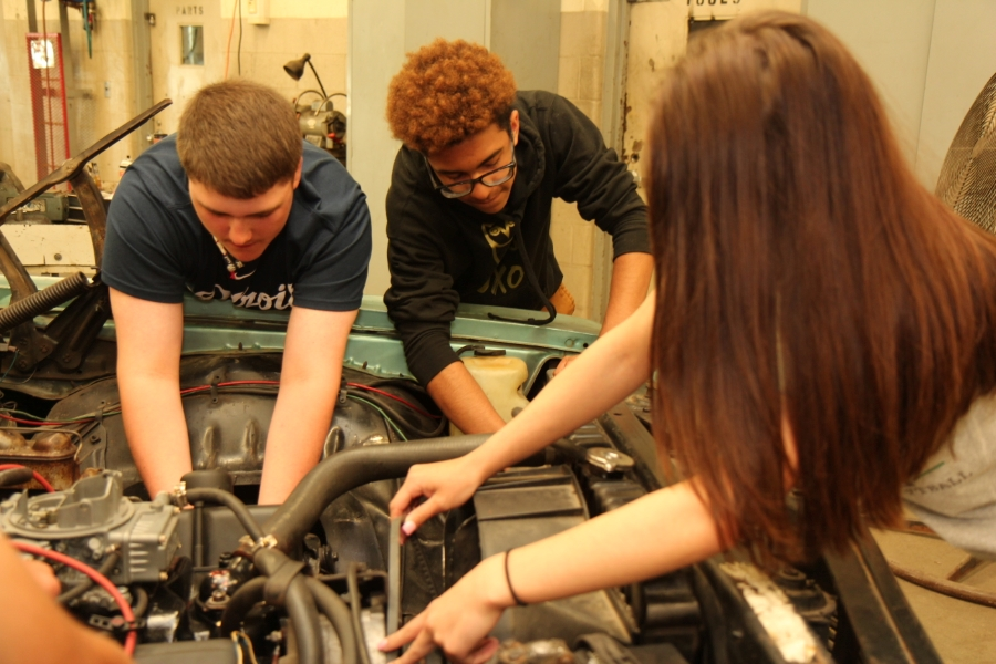 CTE students working on car engine